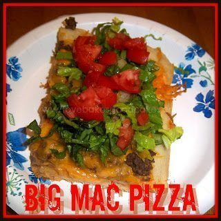 Big Mac Pizza slice with green lettuce and red tomatoes on white plate
