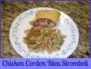 Chicken Cordon Bleu Stromboli with corkscrew pasta salad on white plate