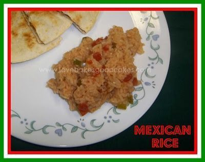 Mexican rice with quesadilla on white plate