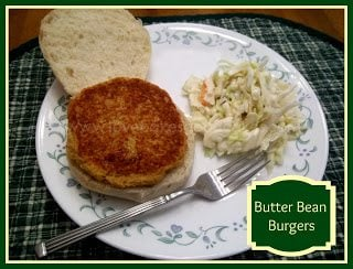 Butter Bean Burger with coleslaw and fork on white plate