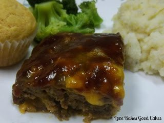BBQ Bacon Cheeseburger Meatloaf with muffin, broccoli and mashed potatoes on white plate