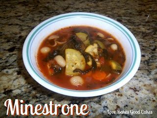 Minestrone soup in white bowl on counter top