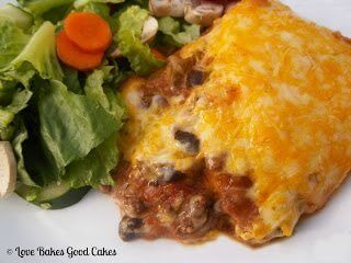 Taco Lasagna with green salad on plate.