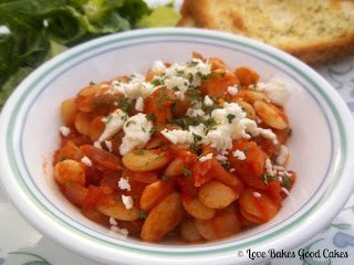 Debra's Greek Baked Beans with Parmesan cheese and spices in white bowl