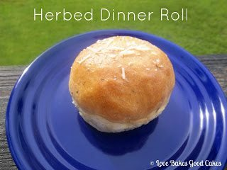 Herbed Dinner Roll on blue plate