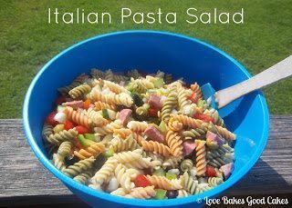Italian Pasta Salad in blue bowl with spoon