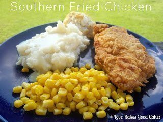 Southern Fried Chicken piece with mashed potatoes and corn on blue plate