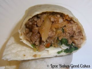 Thai Pork Burritos with cilantro rolled up and open on the end on plate