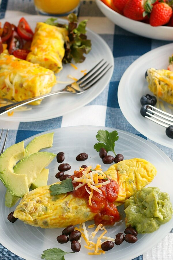 omelets on plates with garnish