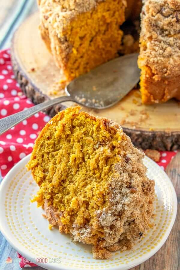 Pumpkin Streusel Coffee Cake piece on plate close up with spoon.
