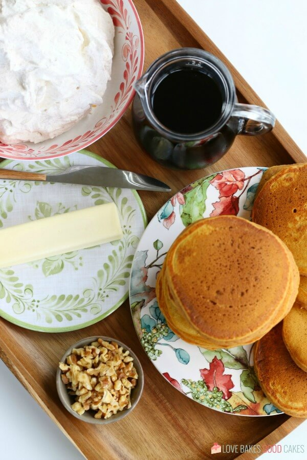 Over-the-top Pumpkin Pancakes with fresh whipped cinnamon cream.