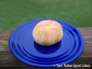 BBQ Bacon Cheeseburger Bun on blue plate.