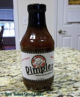 BBQ Chicken Bacon Pasta Bake with Dimples BBQ Sauce bottle on counter top.