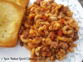 One Pot Goulash with garlic toast on plate.
