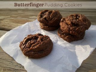 Butterfinger Pudding Cookies stacked on parchment paper.
