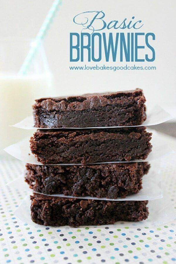 Basic Brownies stacked up with wax paper between pieces.