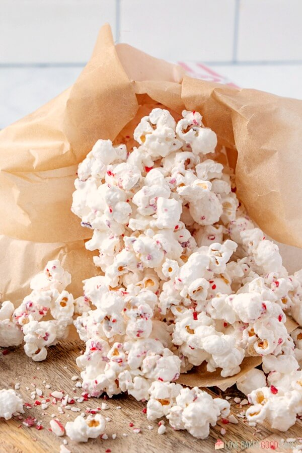 White Chocolate Peppermint Popcorn laying on a cutting board.