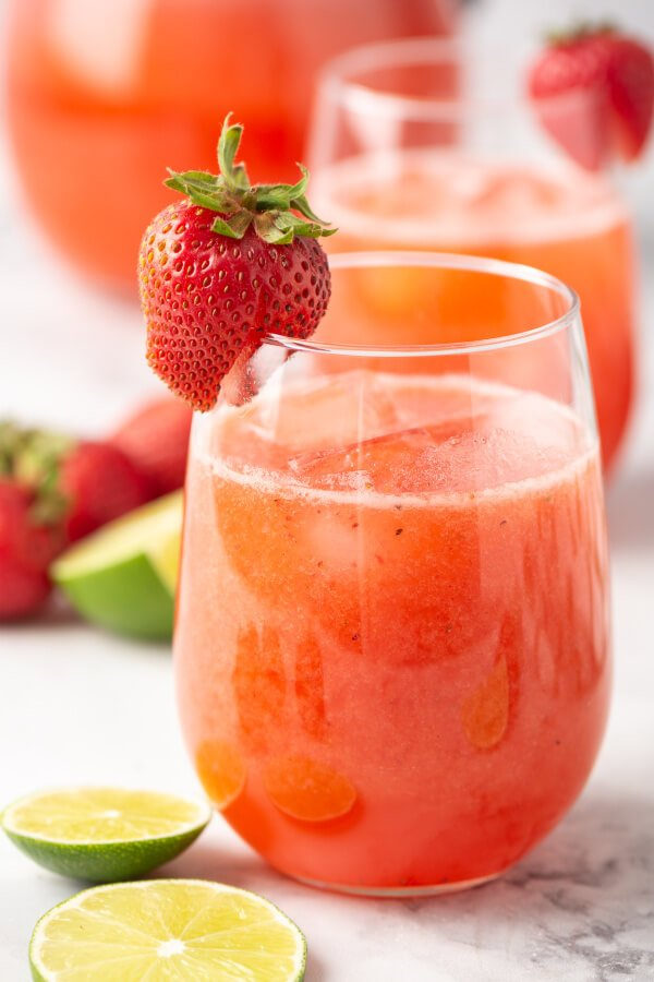 strawberry lime agua fresca in glass with strawberry garnish