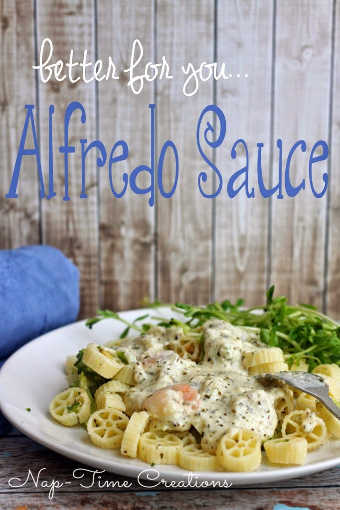 Better for you Alfredo Sauce with pasta on a plate with a fork.
