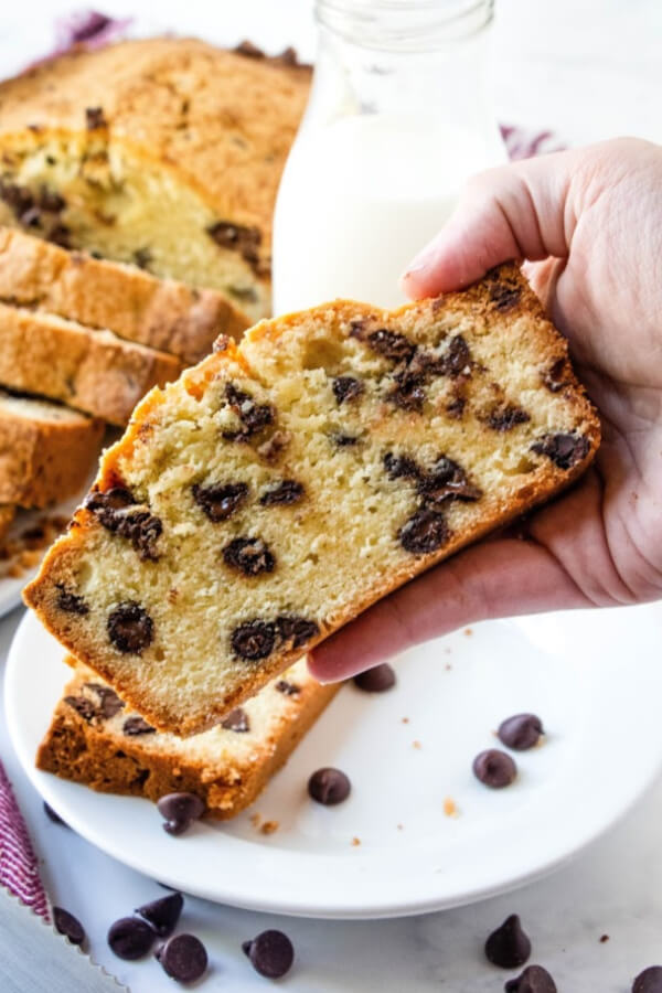 hand holding slice of chocolate chip pound cake