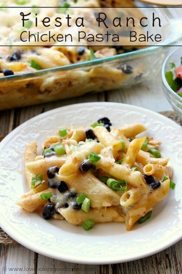 Fiesta Ranch Chicken Pasta Bake on a white plate with a green salad.