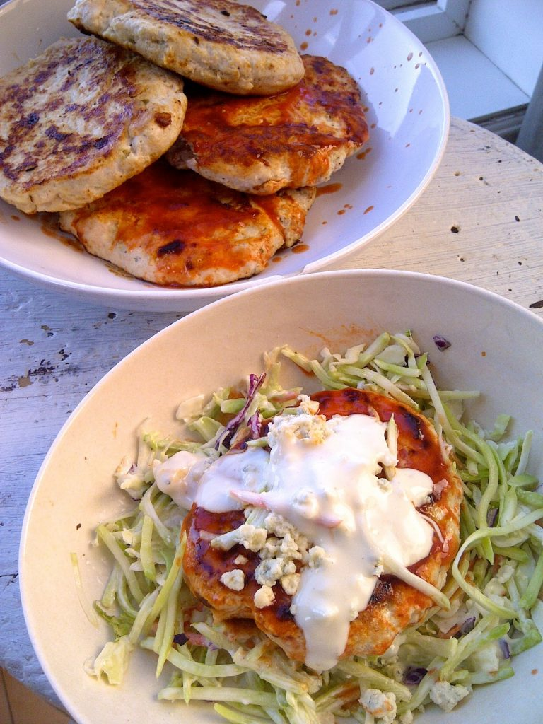 Buffalo Chicken Patties With Blue Cheese Slaw in bowl.