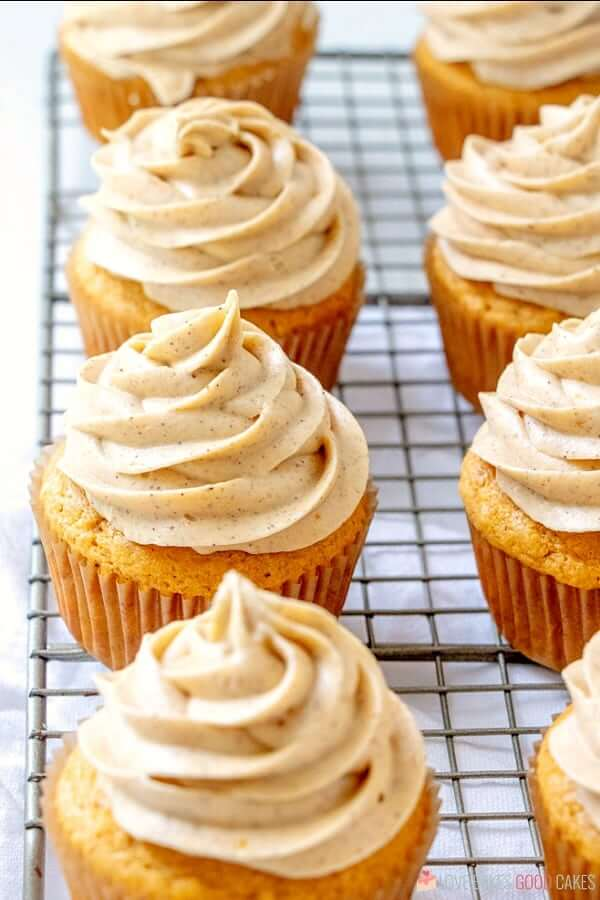 Pumpkin Cupcakes with Pumpkin Spice Cream Cheese Frosting on cooling rack.