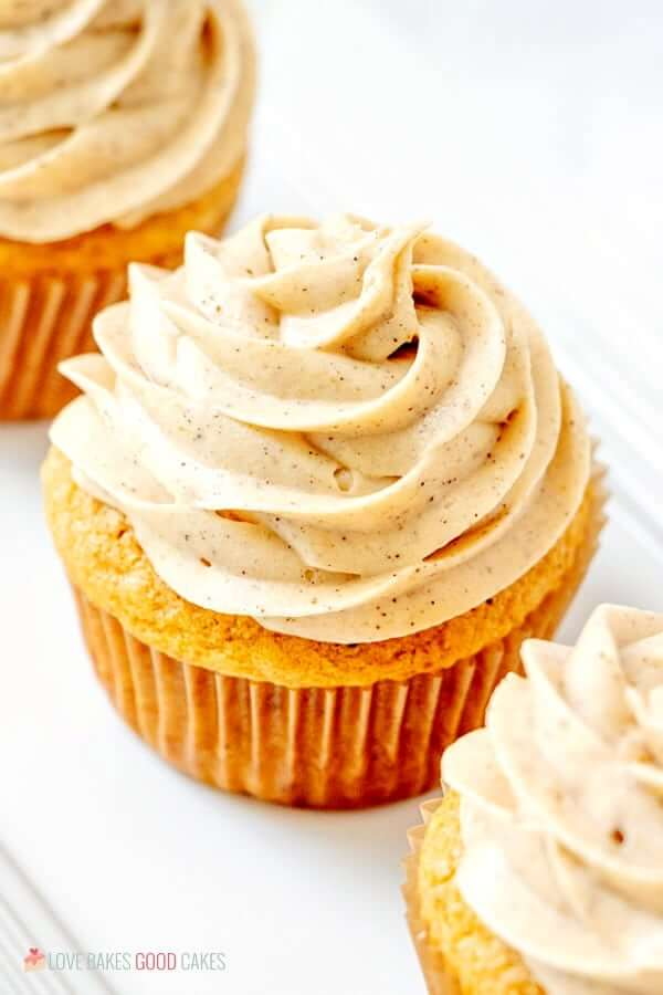 Pumpkin Cupcakes with Pumpkin Spice Cream Cheese Frosting close up view.