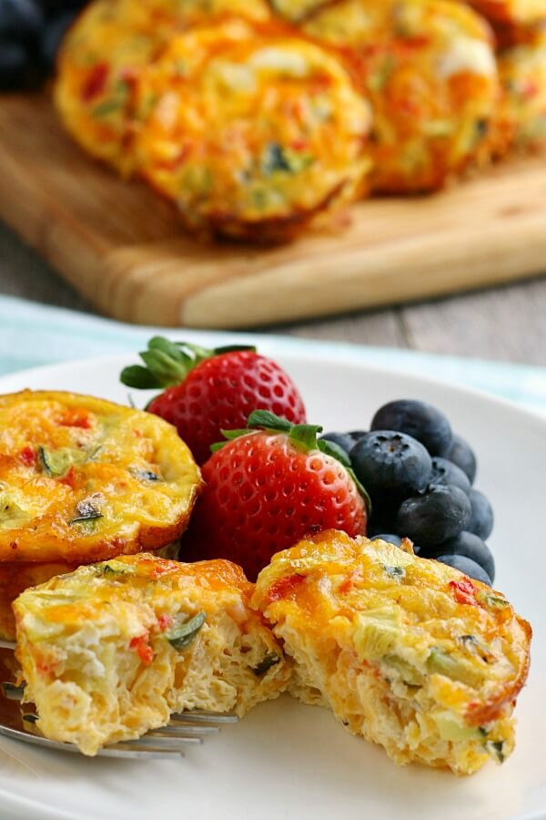 finished breakfast egg muffins on plate with fruit