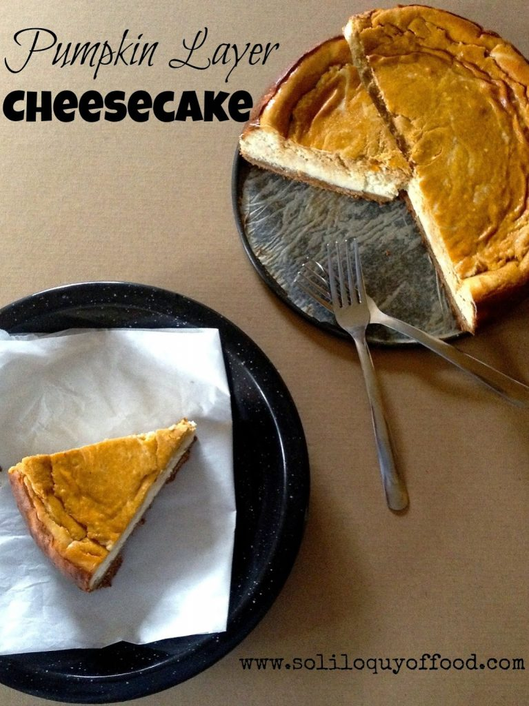 Pumpkin Layer Cheesecake on a plate with two forks.