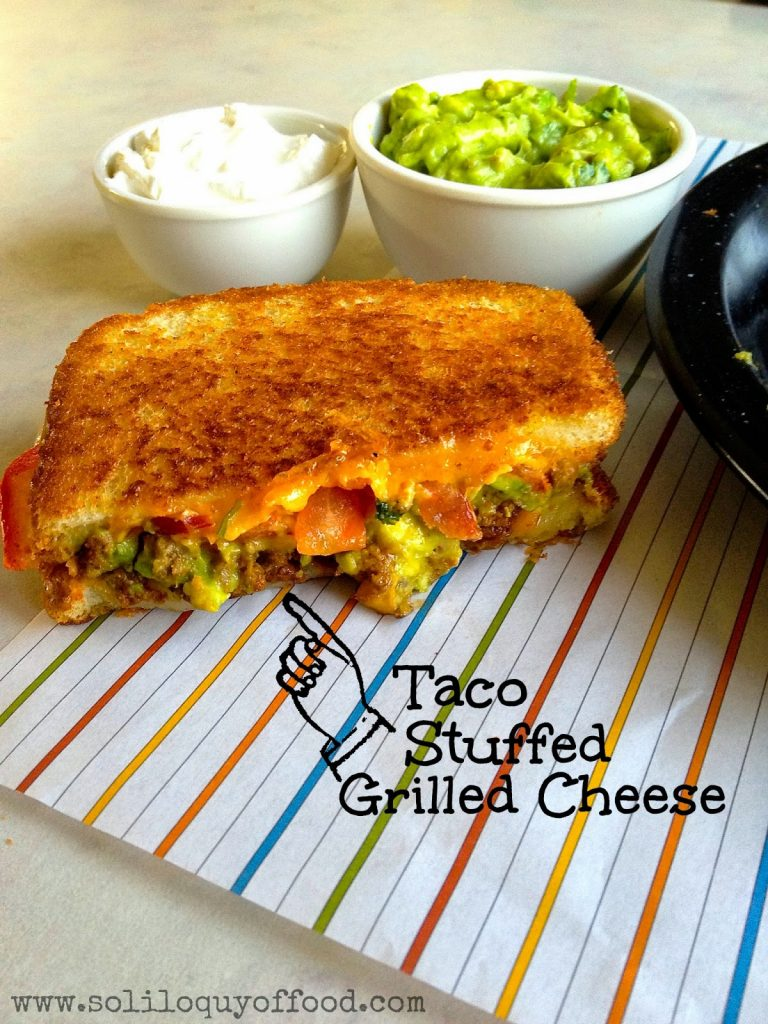 Taco Grilled Cheese sandwich on a place mat.