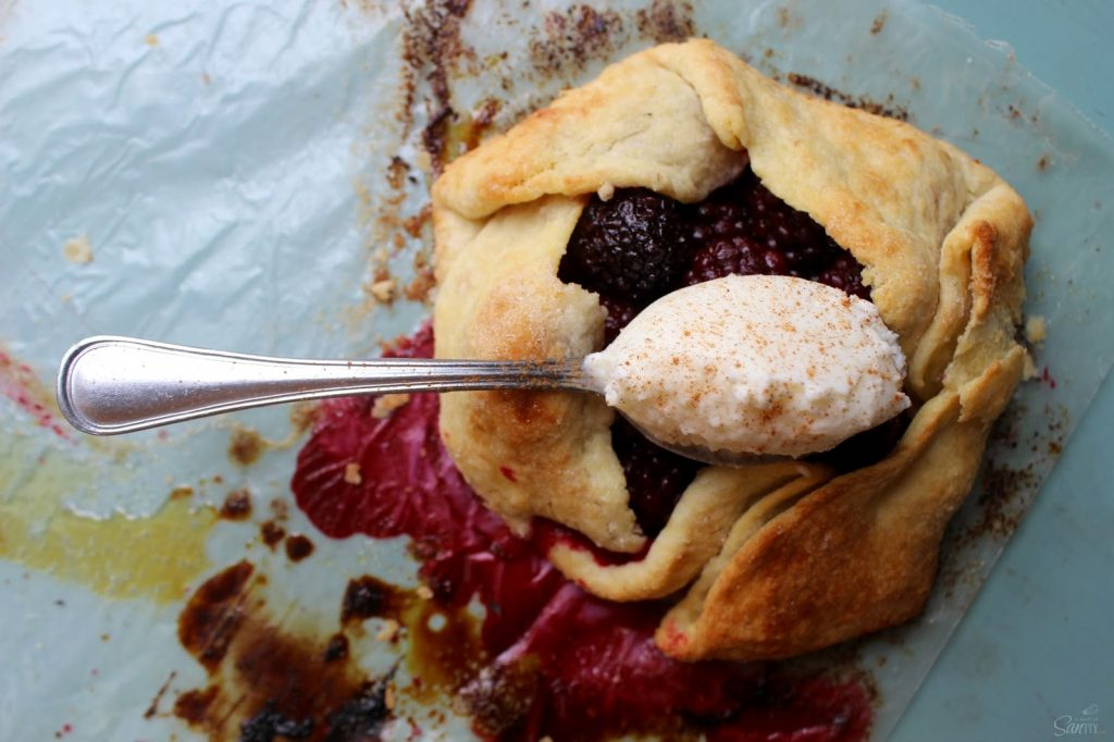 Blackberry Crostata with a spoon.
