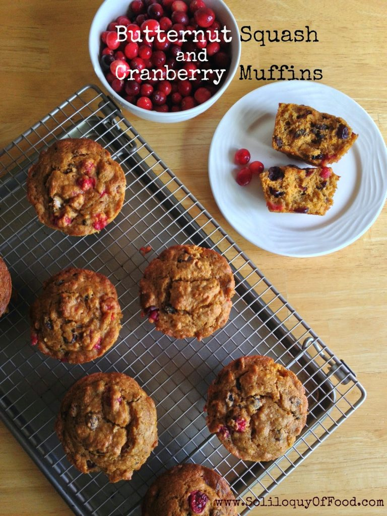 Butternut Squash & Cranberry Muffins on a cooling rack.