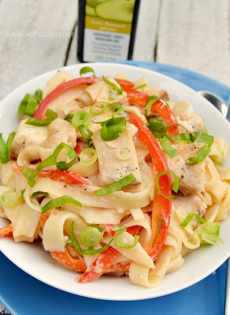 Chicken Fettuccini with Peanut Sauce in a white bowl close up.