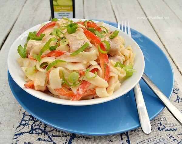 Chicken Fettuccini with Peanut Sauce in a white bowl with a fork.