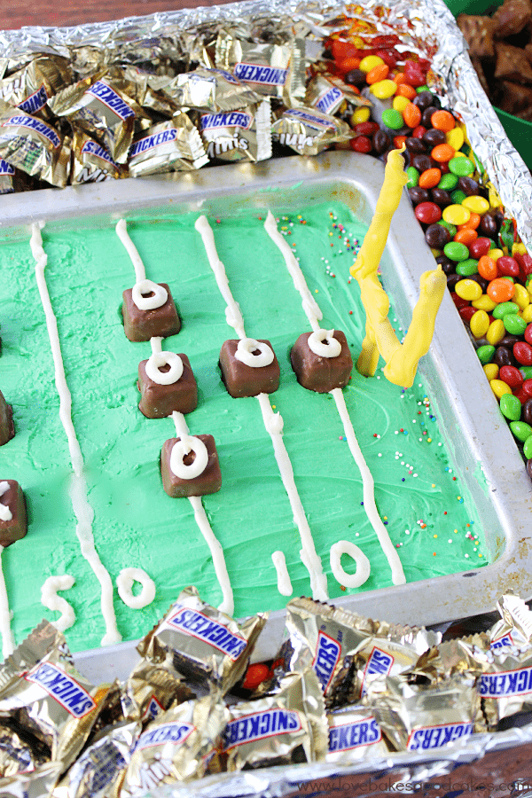 Game Day Cake in a pan with candy around it.