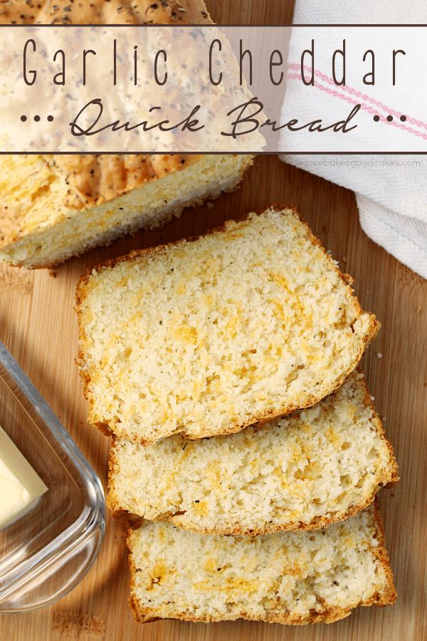 Garlic Cheddar Quick Bread slices on a cutting board.