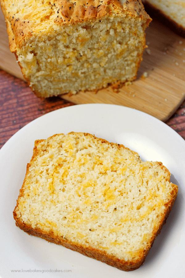 Garlic Cheddar Quick Bread slice on a plate.