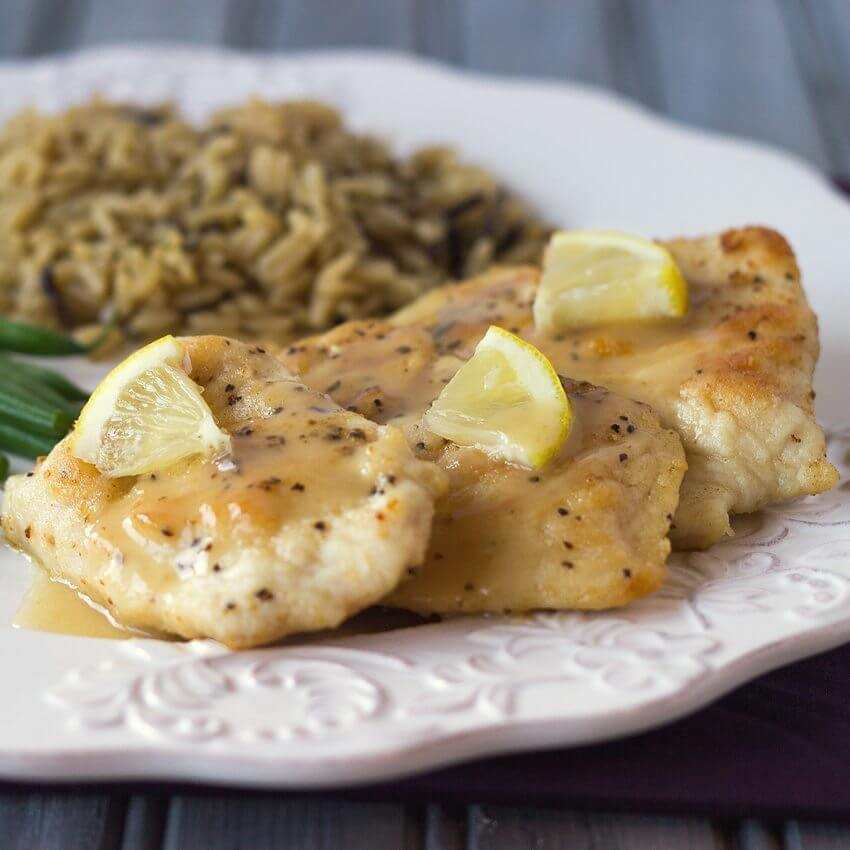 Chicken Piccata on a white plate.