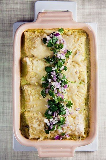 Chicken Enchiladas with Poblano Sauce in a baking dish.