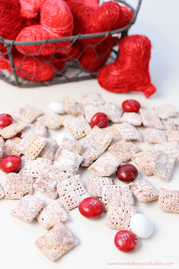 Red Velvet Muddy Buddies laying on a table with red hearts.