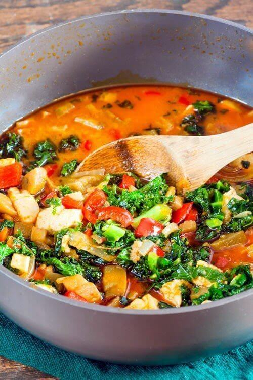 """Red Curry Eggplant and Kale Over Cauliflower """"Rice"""" in a pan."""
