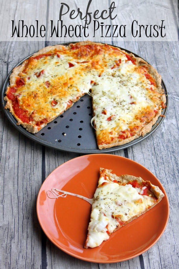 Perfect Whole Wheat Pizza Crust with a pizza on a pizza pan and a slice on a plate.
