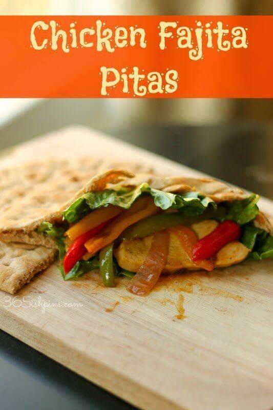 Chicken Fajita Pitas on a cutting board.