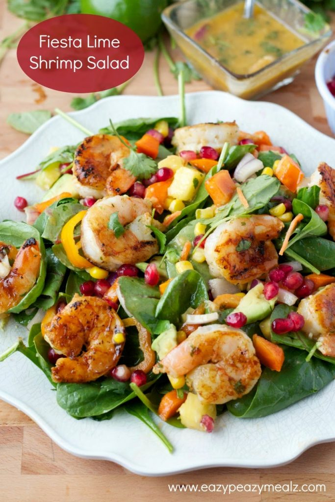 Fiesta Lime Shrimp Salad on a white plate with dressing.
