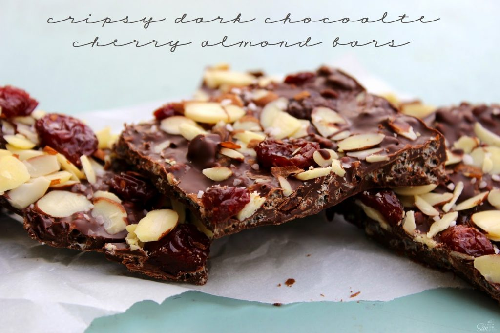 Crispy Dark Chocolate Cherry & Almond Bars on parchment paper.
