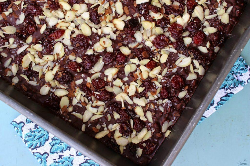 Crispy Dark Chocolate Cherry & Almond Bars in a baking pan.