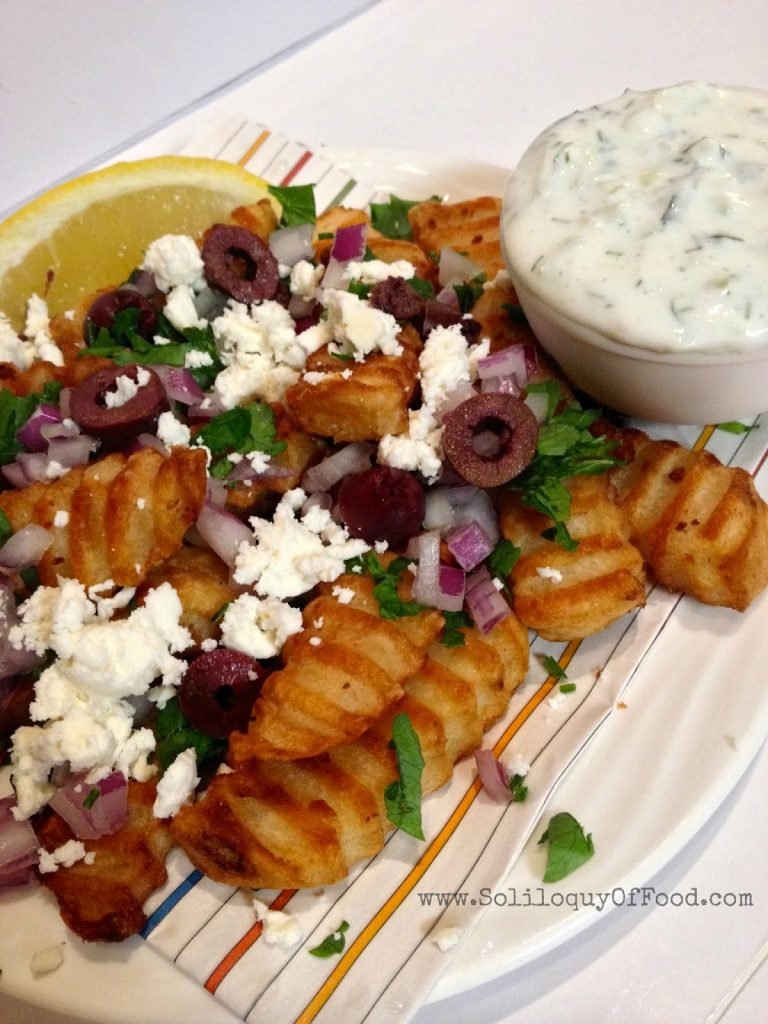 Greek Fries with dip close up.