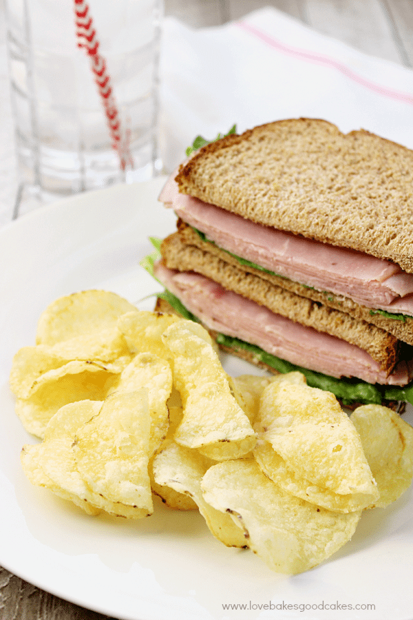 Cape Cod® Potato Chips on a plate with a sandwich.