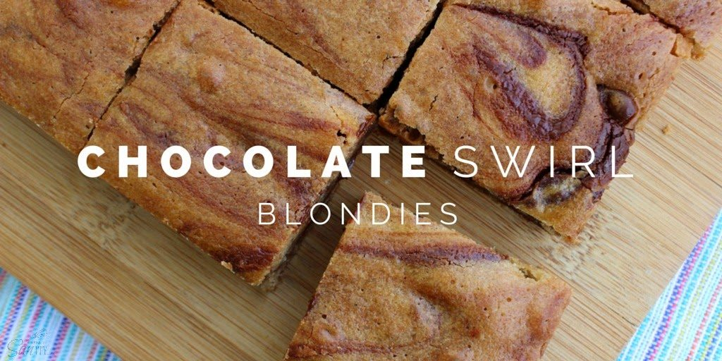 Chocolate Swirl Blondies cut into squares on a cutting board.